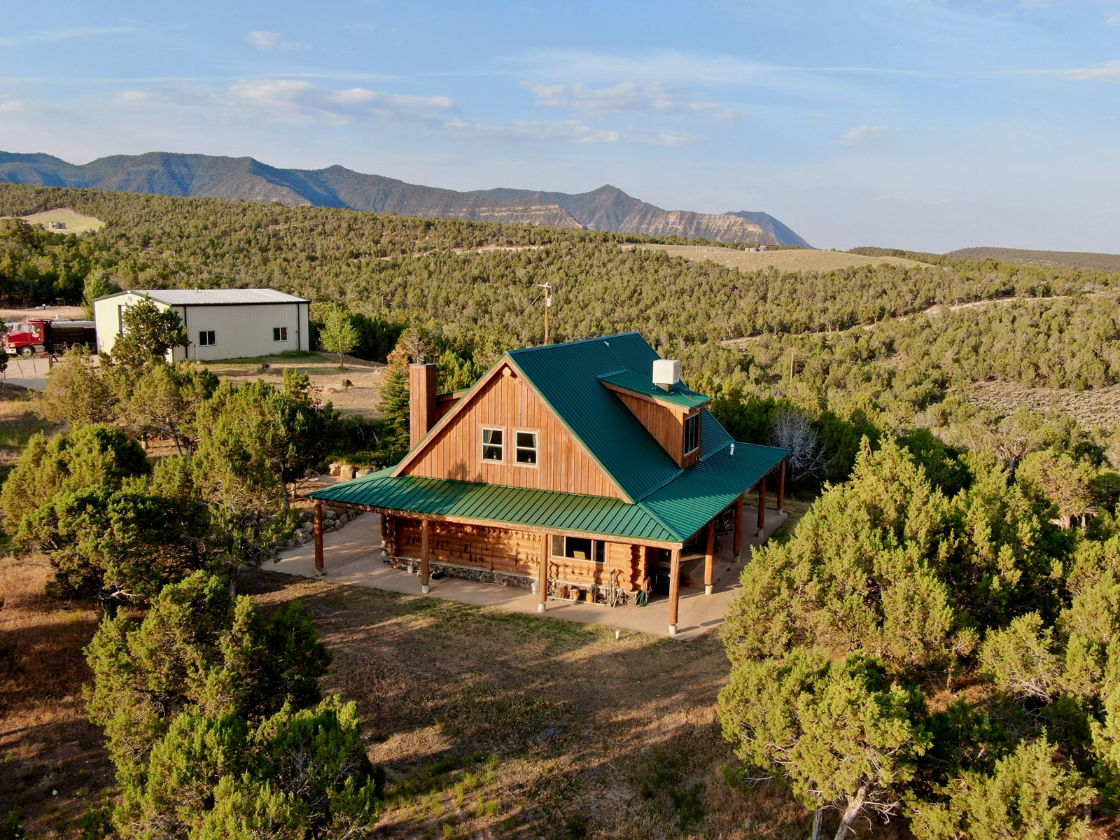 Colorado Custom Log Home with Shop on 40 acres For Sale