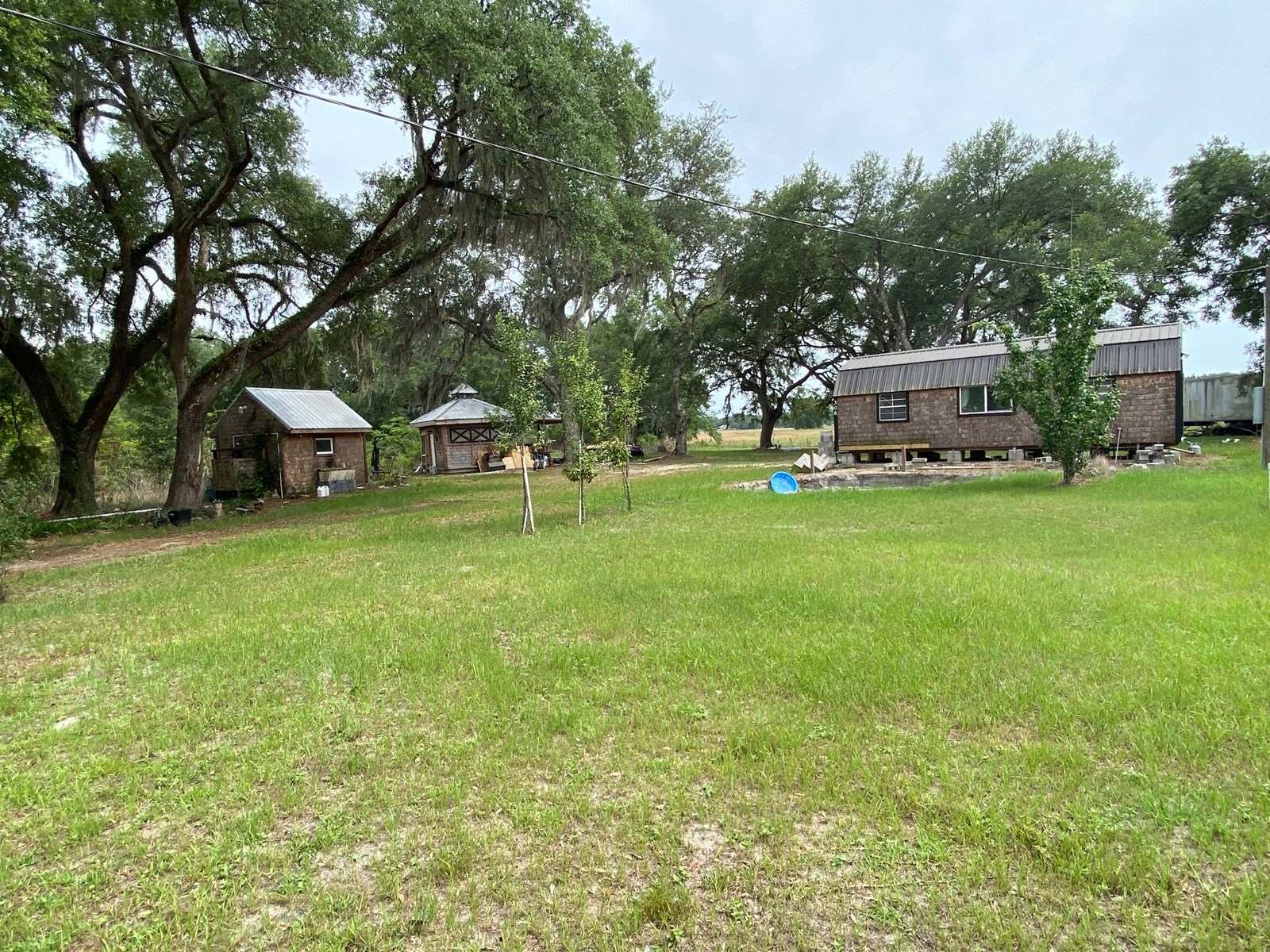 A TRUE TINY HOUSE ON 19+ ACRES FOR $180,000!!!