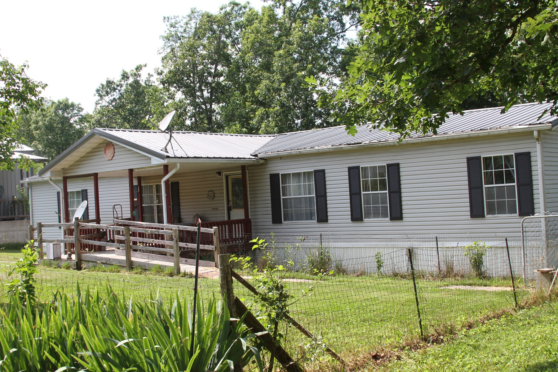 Updated Double wide on 1.6 acres next to Current River!