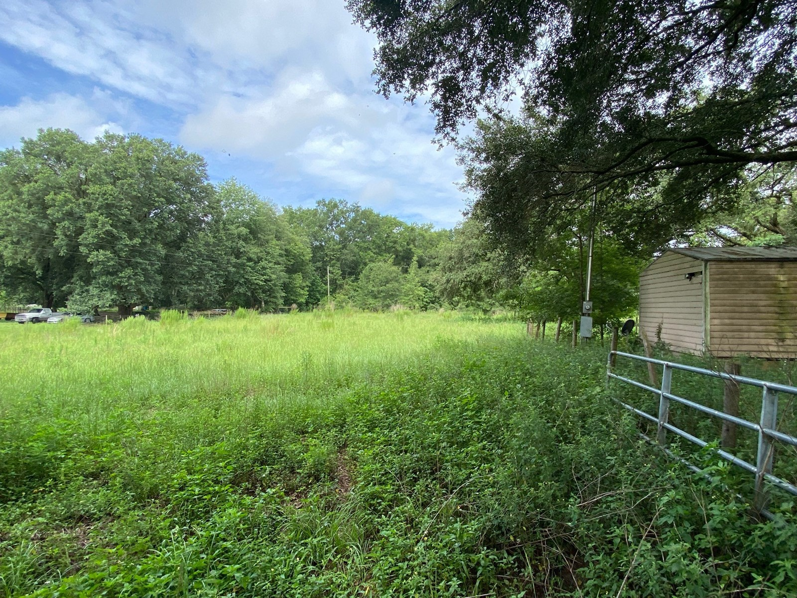 1.74 ACRES WITH WELL, SEPTIC, POWER FOR ONLY $40,000!!