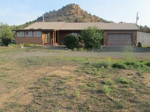 HOME WITH CREEK & BORDERS PUBLIC LAND IN COLORADO