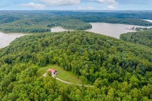 80+ AC WITH HOME ADJOINING 6600 AC STATE LAND/1800 ACRE LAKE