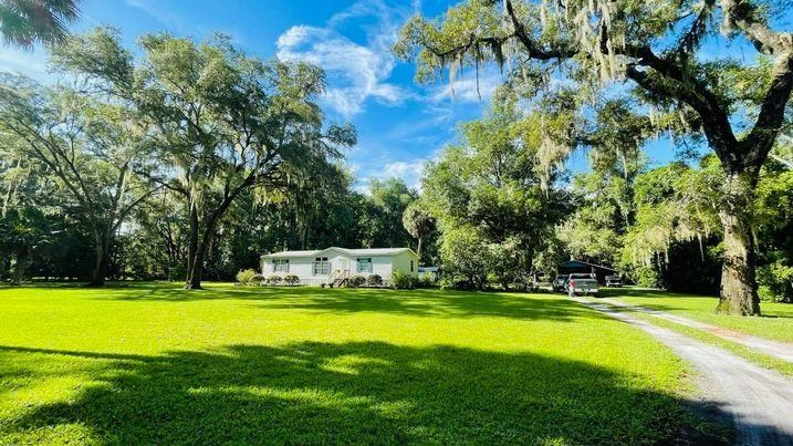 5 ACRES OF PRIVATE COUNTRY LIVING!