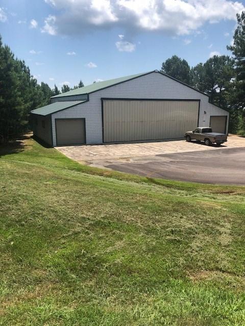 Airplane Hangar w/Living Quarters on 3 Acres For Sale Ozarks