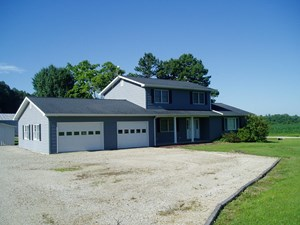 FOUR BEDROOM TWO BATH HOME SETTING ON 3 ACRES M/L IN S.E.MO.