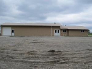4,032 SQ FT FACILITY WITH LARGE PARKING AREA AND GARAGE