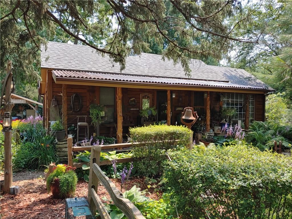 Rustic Cabin Feel on Gorgeous Landscaped 1+/- Ac Corner Lot