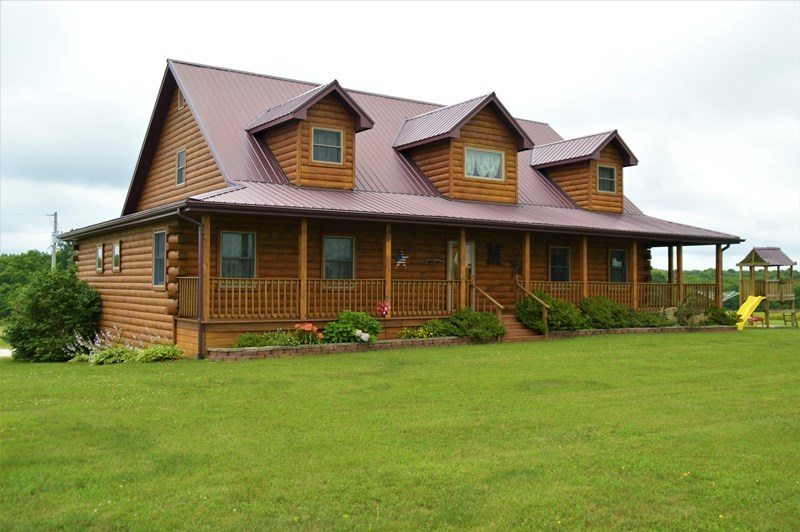 Custom Log Home with Shop and 3 +/- Acres for Sale in Shelby
