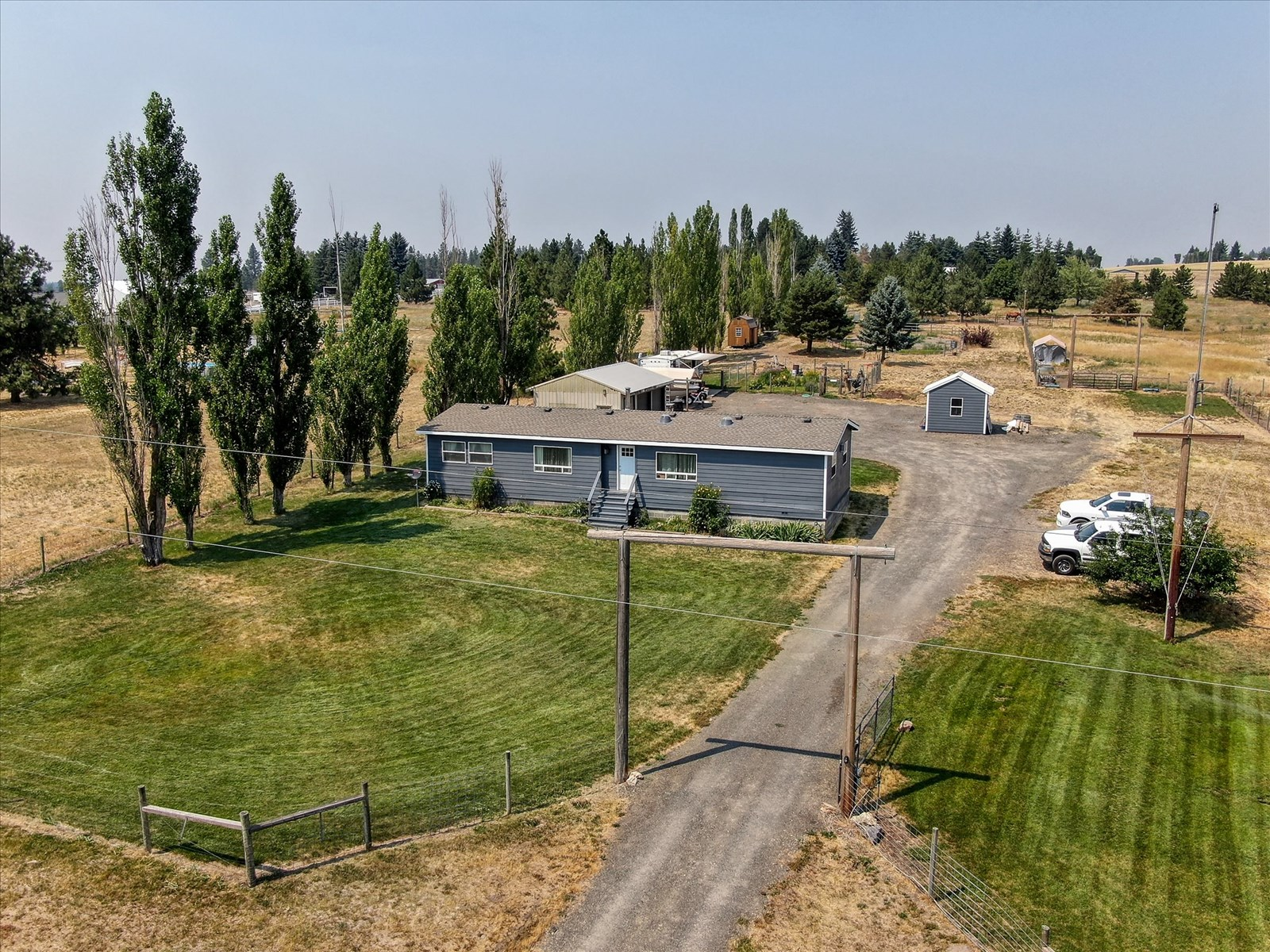 5 1/2 acres ready for your horses!Updated Manufactured Home