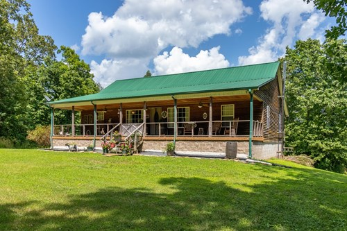 Log Home with Acreage for Sale in Hohenwald, Tennessee