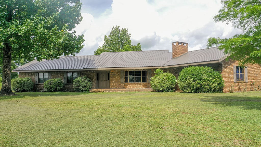 GORGEOUS BRICK HOME in the COUNTRY IS A MUST-SEE!