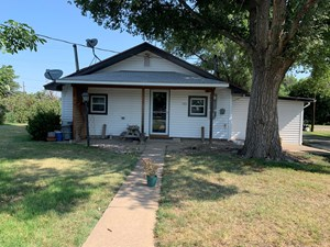 HOME WITH RV HOOK-UPS FOR SALE IN MULLINVILLE, KS