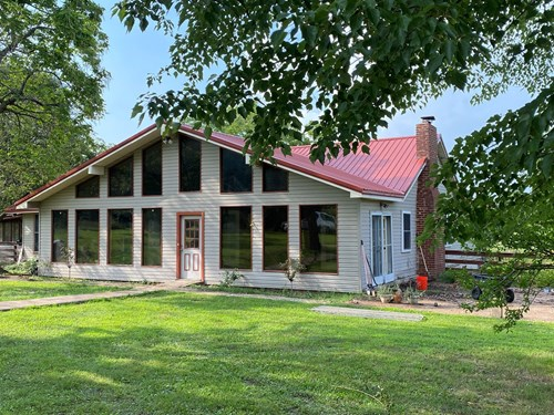 ARKANSAS COUNTRY HOME WITH ACREAGE