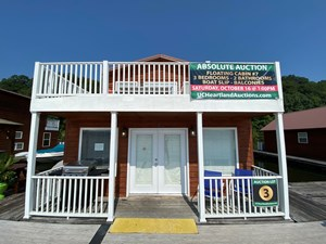 FLOATING CABIN SELLING AT ABSOLUTE AUCTION GREEN RIVER LAKE