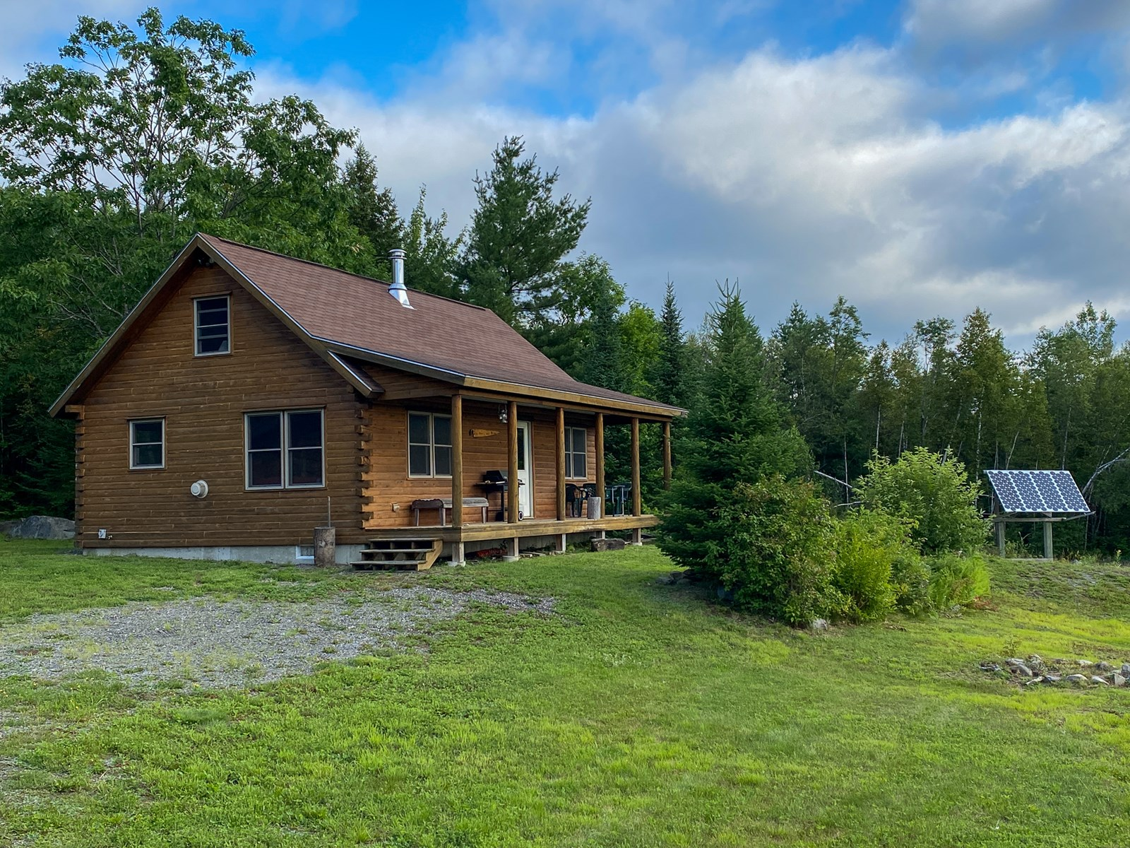 Log Cabin on Trout Stream with 190 +/- Acres