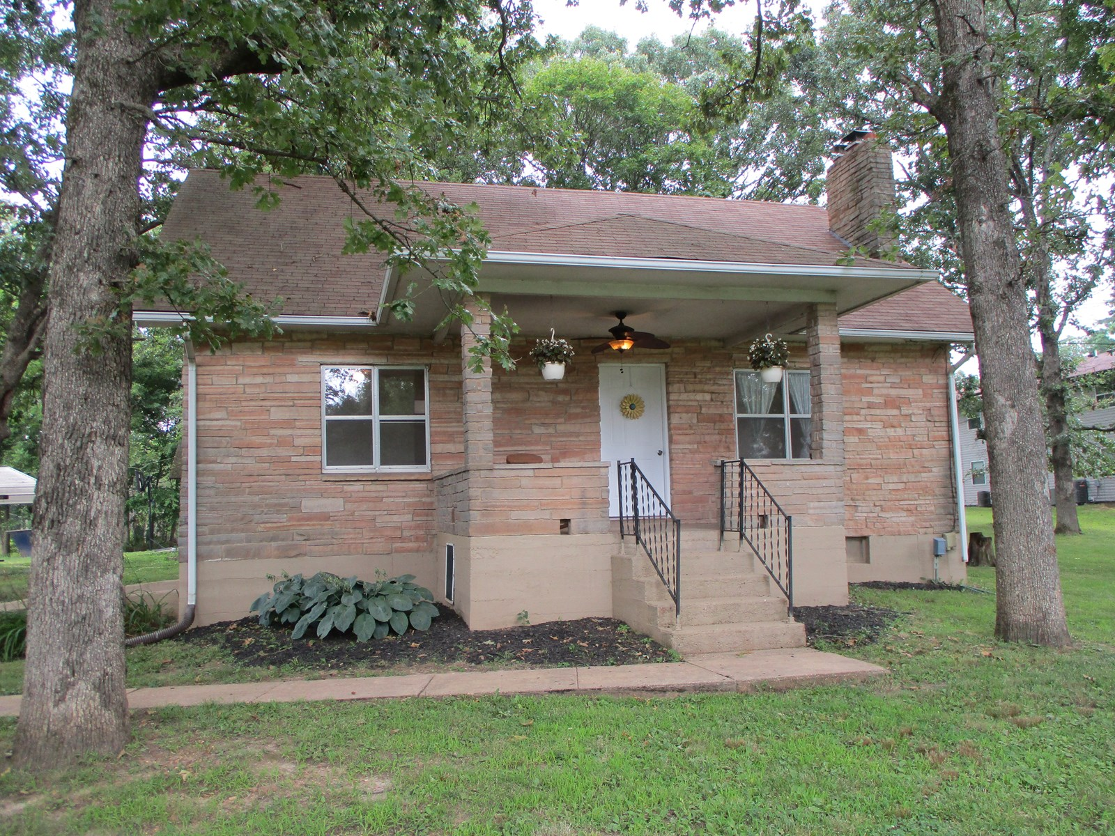 4 Bedroom, 1 1/2 Bath Stone Home on a little over 1 acre.