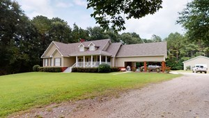 COUNTRY HOME WITH 44 ACRE, POOL, POND AND SHOP.