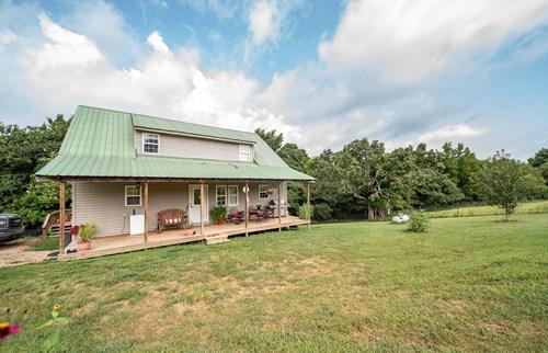 Southwest Missouri Home on 177 Acres