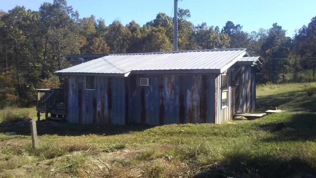 $4,000 PRICE DECREASE- TWO BEDROOM CABIN WITH 5 ACRES