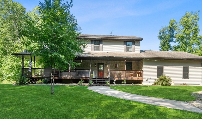 Beautiful 4BR, 4 BA Country Home Located on 25 wooded acres