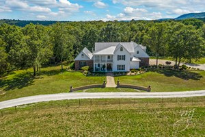 FARMHOUSE STYLE HOME ON 21 ACRES IN HARRISON FOR SALE
