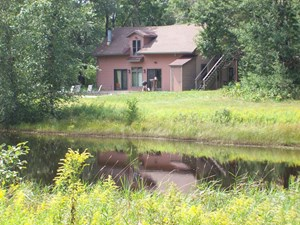 2 STORY HOME WITH 164 ACRES OF YEAR-ROUND ACTIVITIES