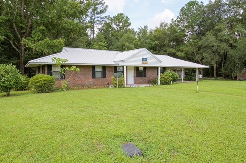 Brick Ranch Home in Town with Pond!