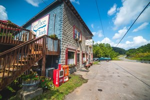 WORKING BUSINESS WITH CABINS, STORE, RESTAURANT FOR SALE