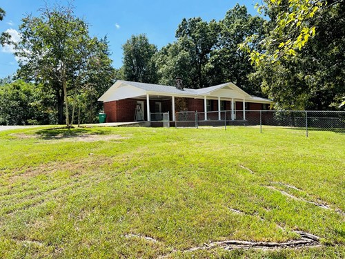 Home with large shop and 5 acres near the White River