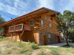 AUTHENTIC HEWN LOG HOME ON 5.14 ACRES FOR SALE IN CO