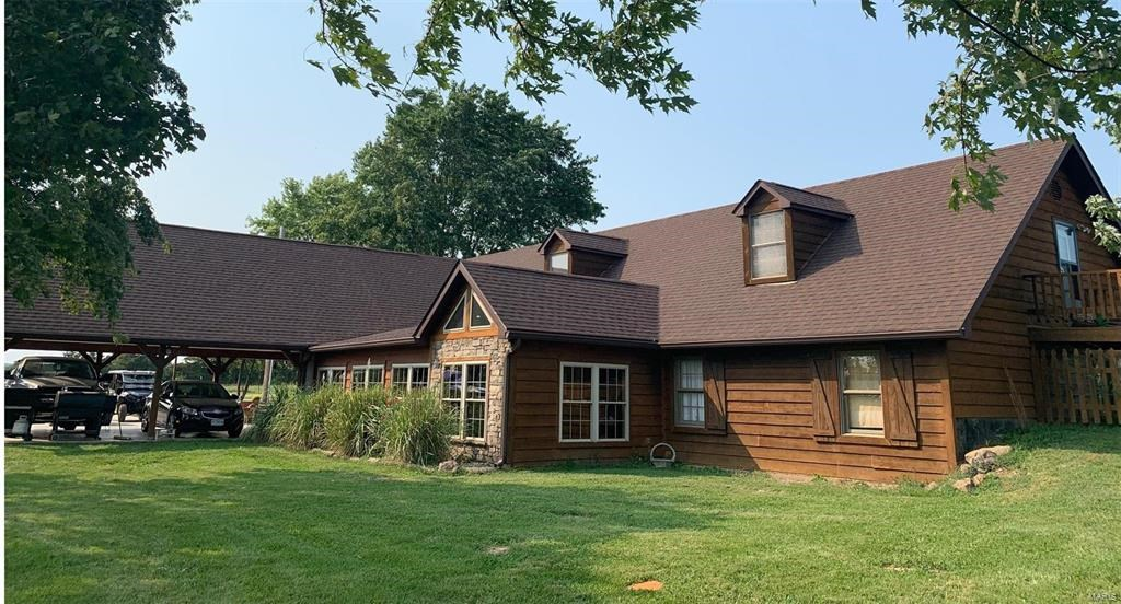 3,500 SQ FT home with 4 bed, 3 bath on 20 acres. Large barns