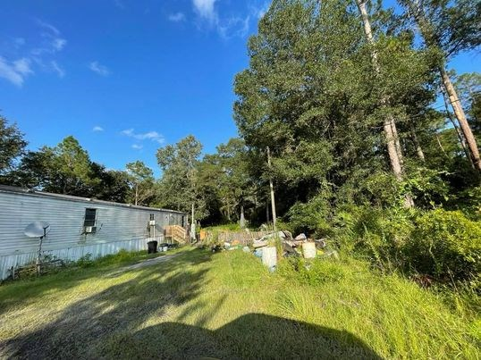 MOBILE HOME WITH ACREAGE IN BRONSON FLORIDA!