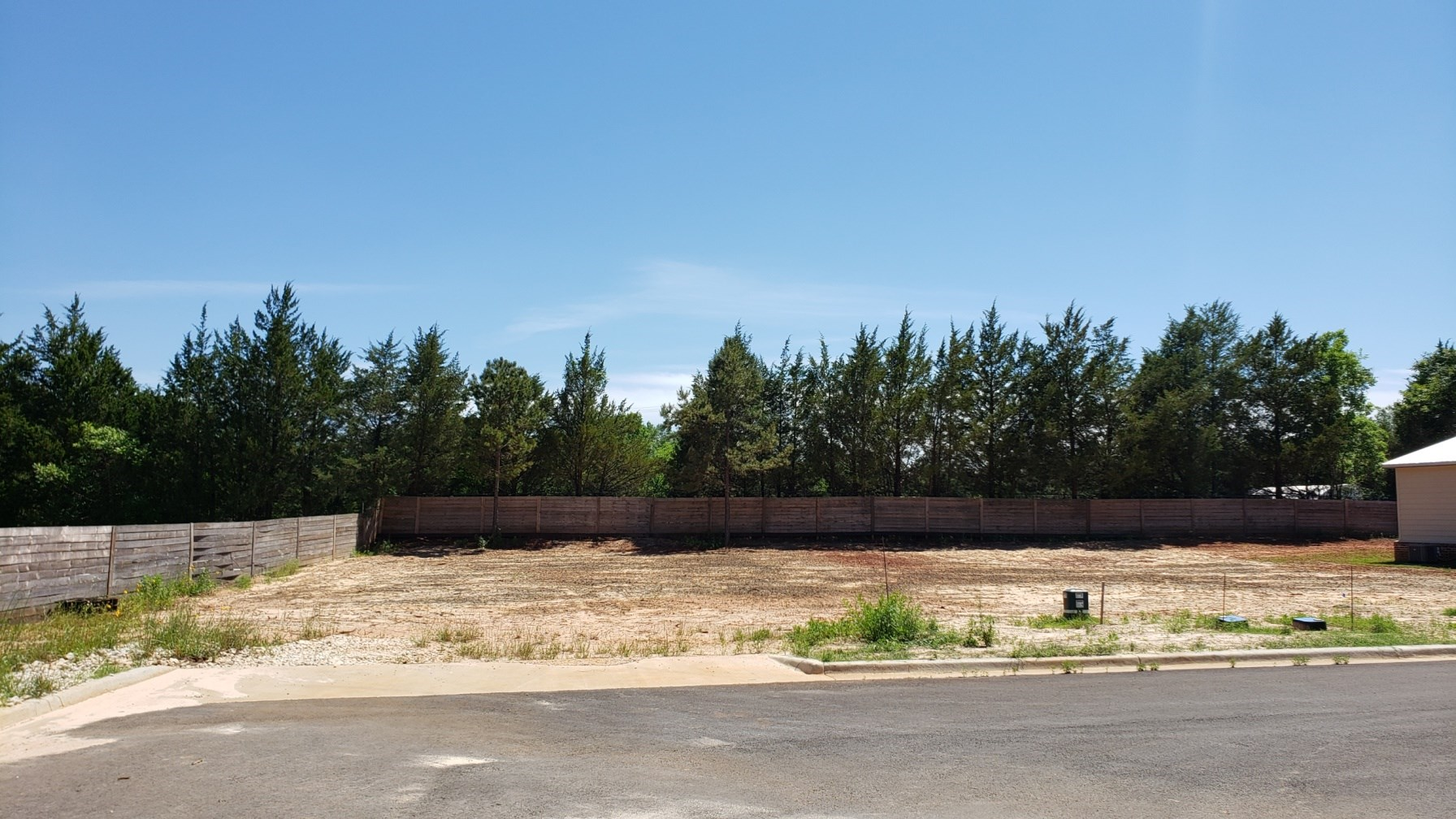 LEVEL LOT SURROUNDED BY NEW HOME CONSTRUCTION