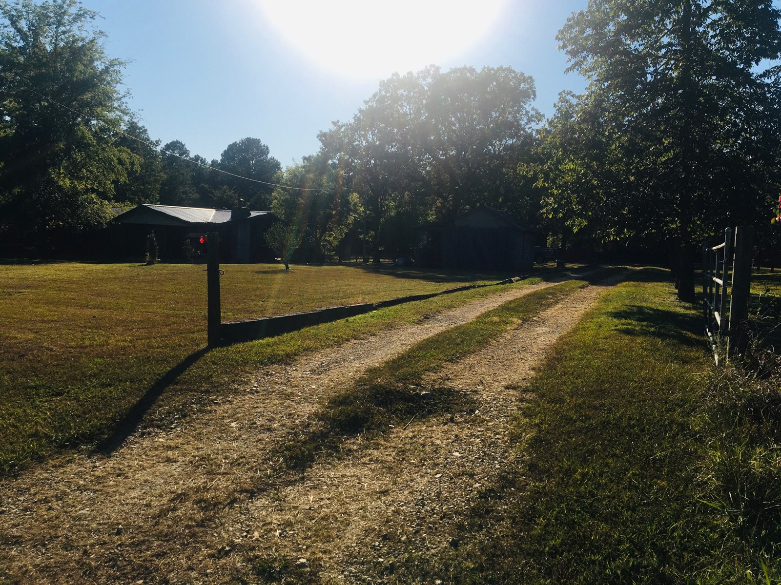 VERY WELL MAINTAINED HOME ON 20 ACRES WITH PAVED  FRONTAGE