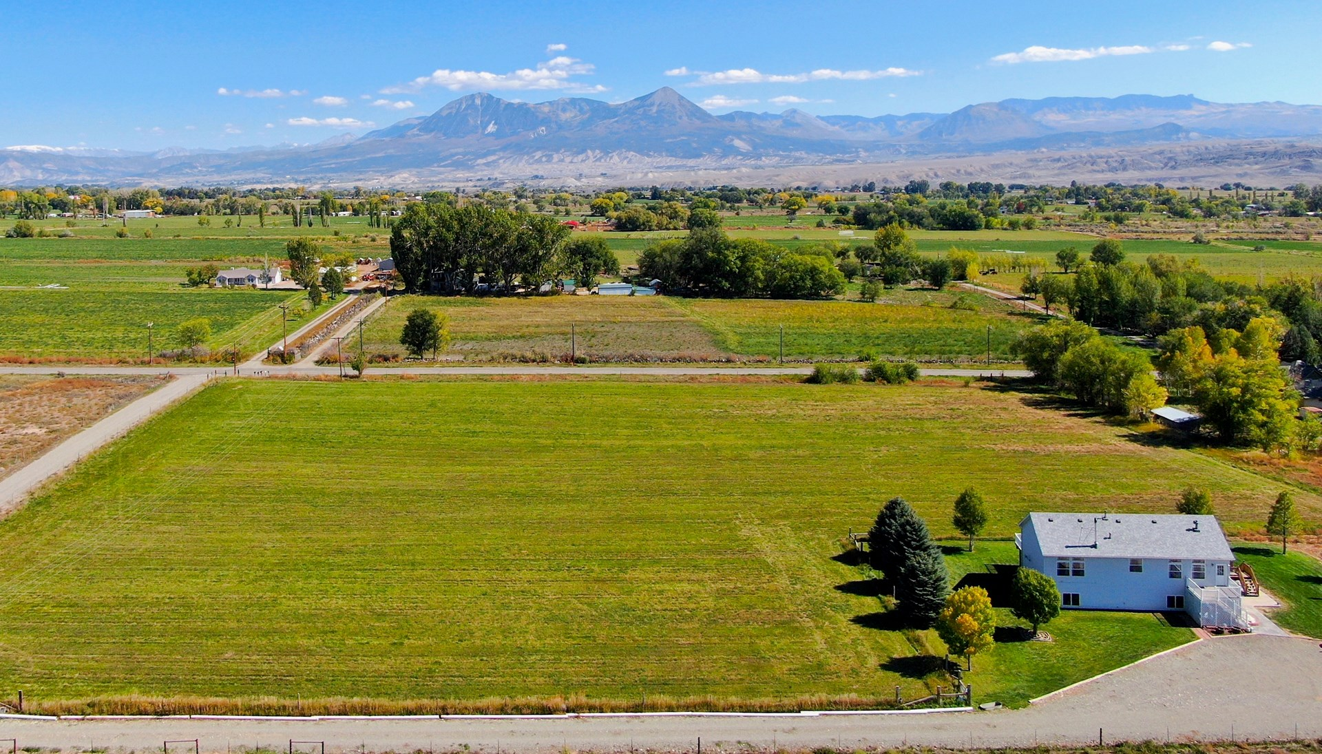 Colorado country home with irrigated hayfield mountain views