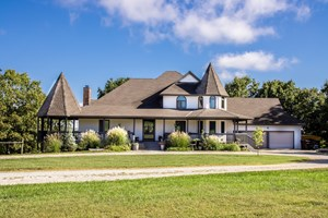 GORGEOUS CUSTOM BUILT COUNTRY HOME ON 18 +/- ACRES