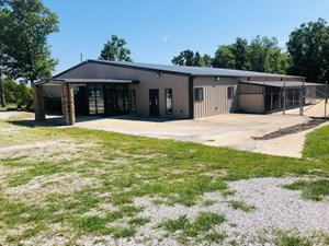 GREAT COMMERCIAL TRACT WITH BUILDINGS!