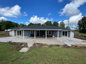 EFFICIENT EARTH CONTACT HOME ON 40 ACRES W/HIGHWAY FRONTAGE