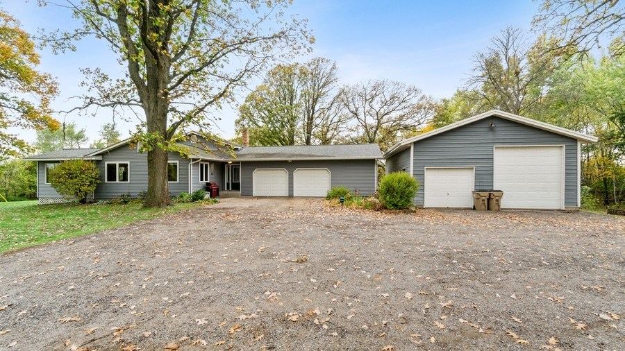 Beautiful 3 bedroom home on 5.6 acres with large outbuilding
