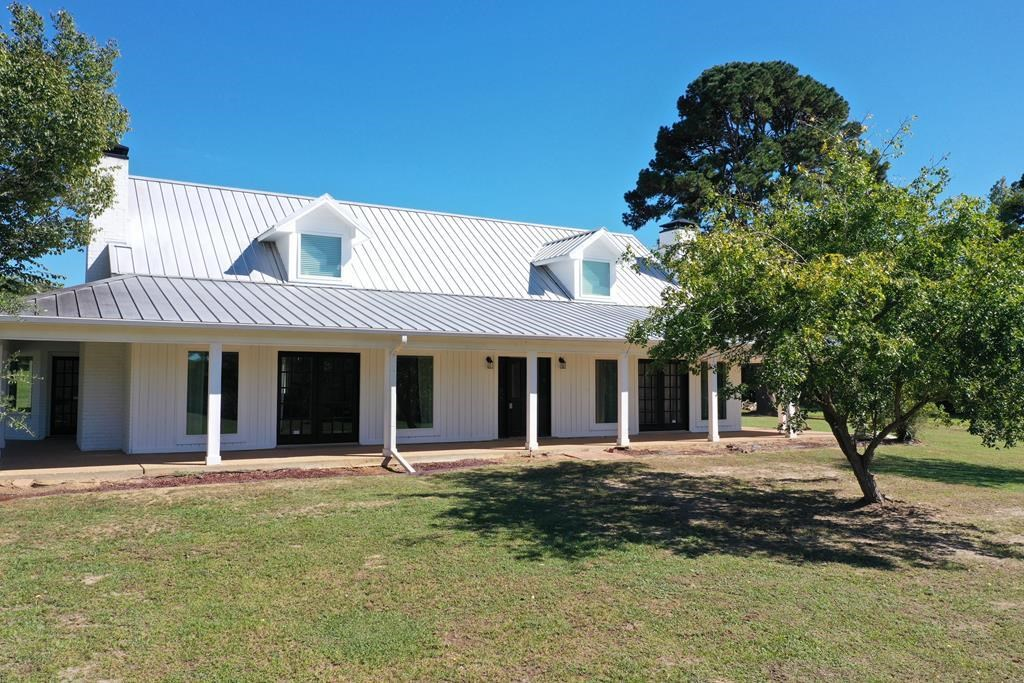 2 STORY COUNTRY HOME IN EAST TEXAS WITH LAND AND POND