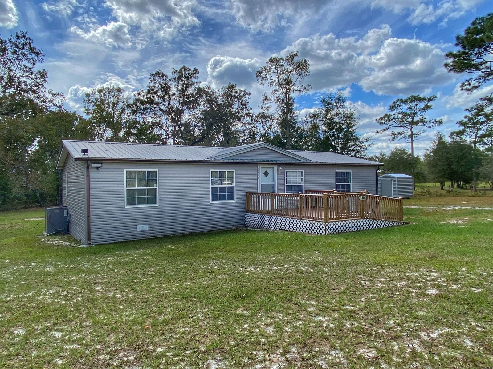 BEAUTIFUL MOBILE HOME WITH ACREAGE!