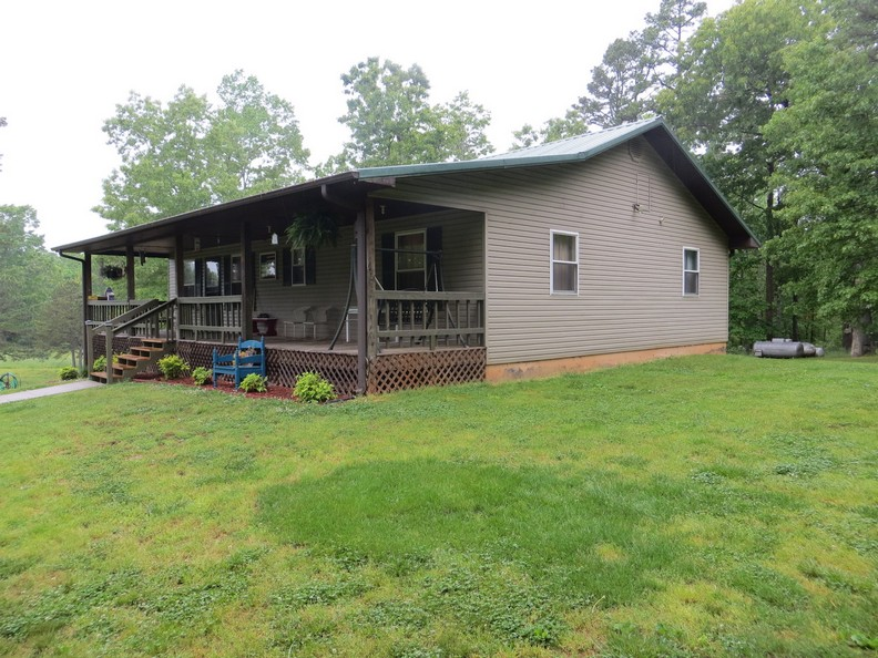 Home on 70 AC bordering Mark Twain National Forest FOR SALE