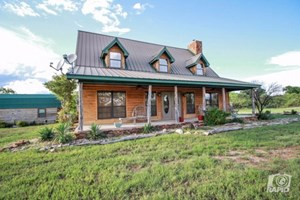 RIVER FRONT HOME WITH OUTDOOR PAVILION ON 7 ACRES IN WEST TX