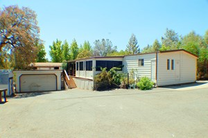 LAKE OROVILLE HOME FOR SALE BACKS UP TO BIDWELL MARINA