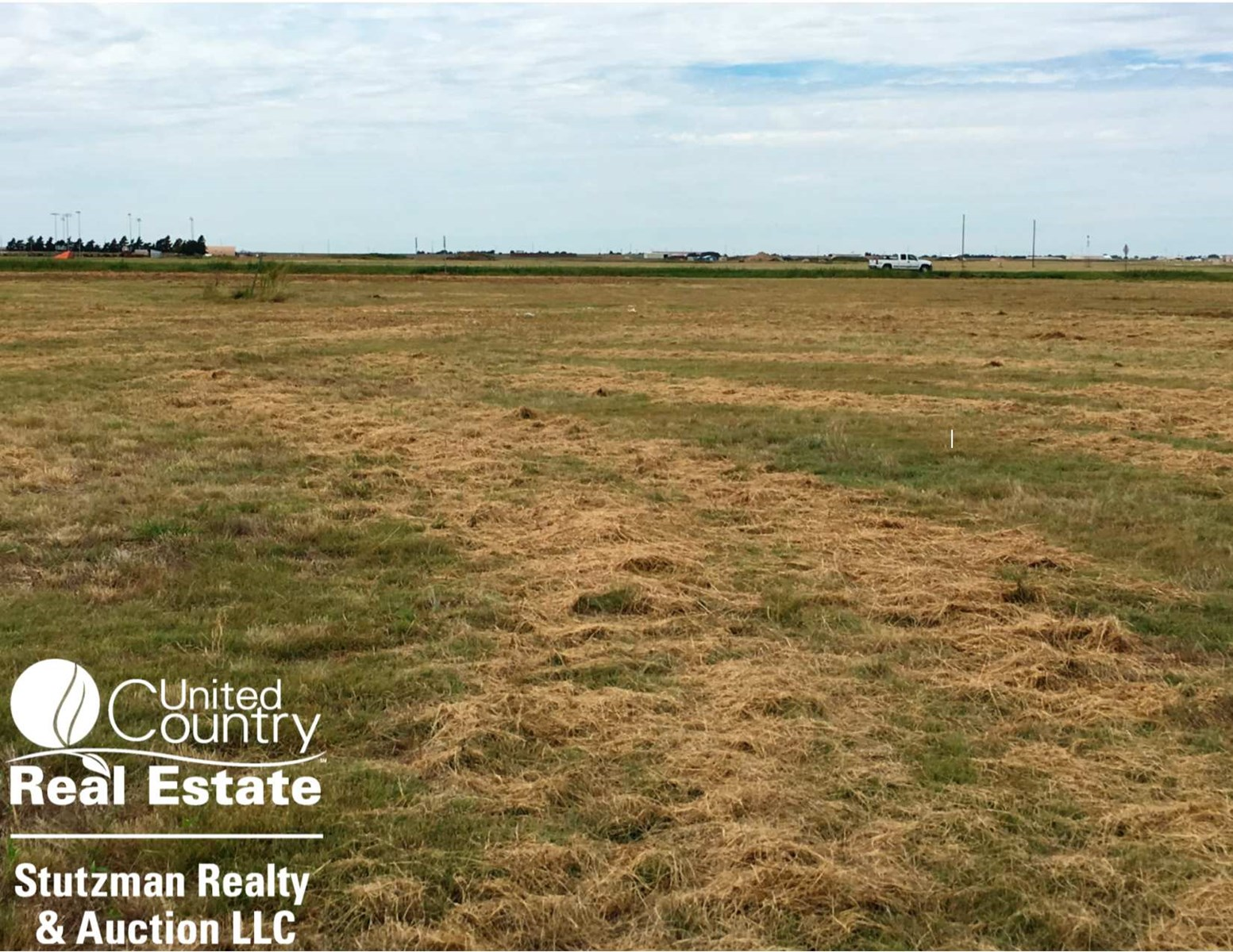 COMMERCIAL PROPERTY  AND VACANT LAND FOR SALE IN ULYSSES, KS