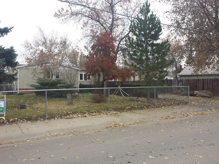 SHELBY MT MOBILE HOME FENCED LOT  TREES
