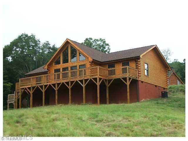 Log Cabin Home for sale in Danbury, NC. Custom Built