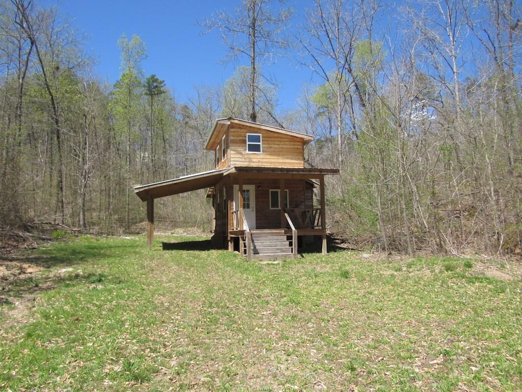 Tiny Home w/ 35.5 Acres & Spring $125,000