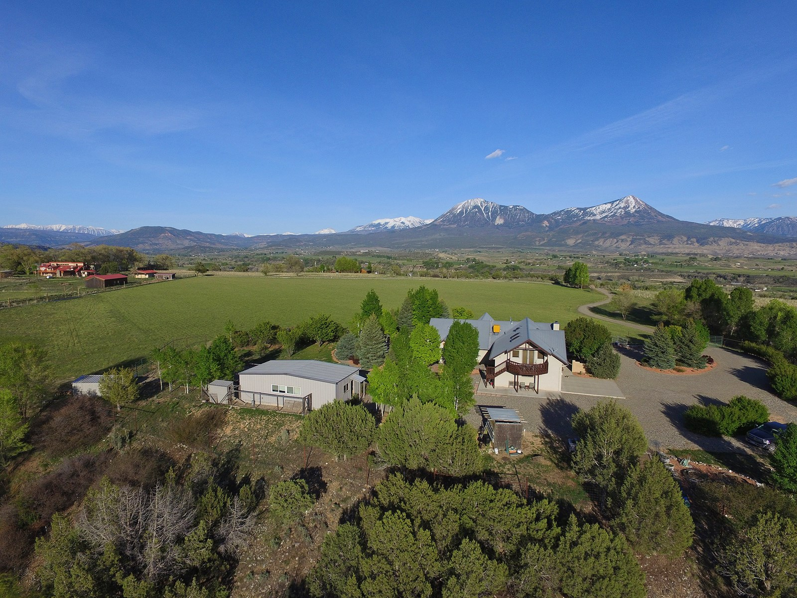 Colorado luxury home with irrigated hayfield, stunning views