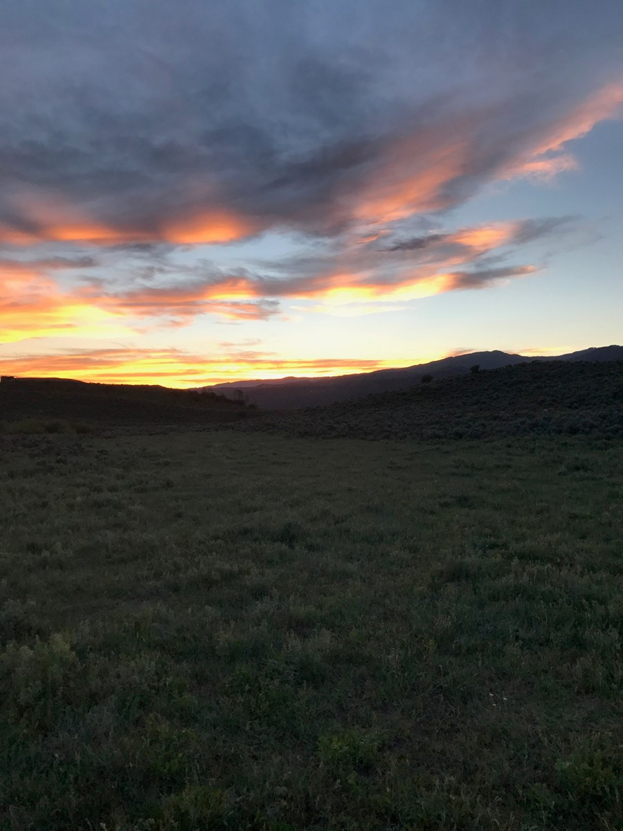 Acreage for sale with pond in western Colorado
